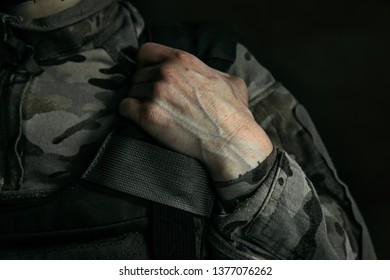 There is no fear in my veins. Close up shot of arms of young female soldier. Woman in military uniform on the war. Depressed and having problems with mental health and emotions, PTSD.