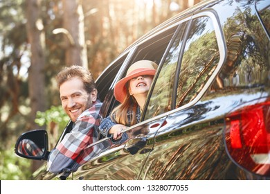 There are no perfect parents and children, but there are plenty of perfect moments along the way. Father and daughter looking out the car window and smiling happily at the camera. Family road trip