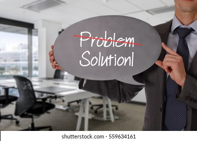 There is no problem only solution. Businessman holding blackboard. Business vision, success, team work, leadership concept