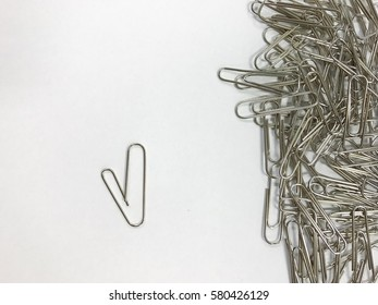 There is one paper clip heart shape different from bunch of paper clip