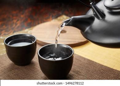 There is Satsuma ware called 'Kurojoka' as a Japanese sake related tool to warm shochu.