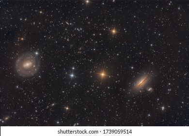 There are several galaxies in this image. The larger ones, NGC 5078, on the right, is an edge on and the one on the left is NGC 5101, a barred spiral galaxy. They are in the Constellation Hydra and ab
