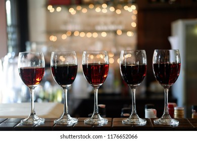 There are several types, such as glass, wine glass, Red Wine Glass at bar and wine table party
