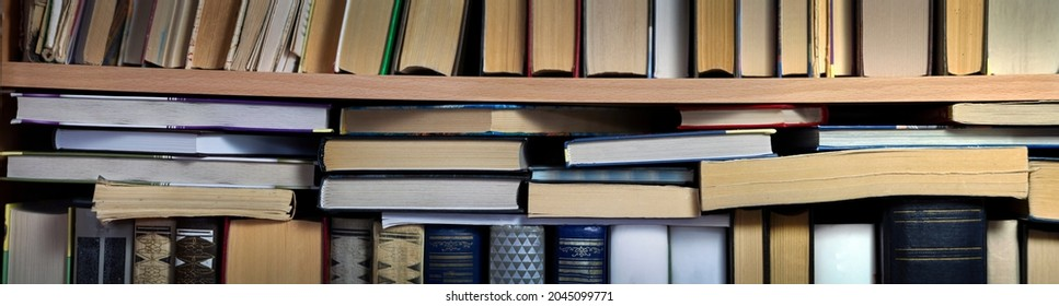 There are stacks of books on the standing books. Close-up. Panorama. Background for libraries, science, education.