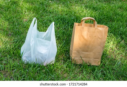 There are two bags on the strava, one made of paper, the second made of plastic. The best choice is a paper bag. Paper is an environmentally friendly material. - Shutterstock ID 1721714284