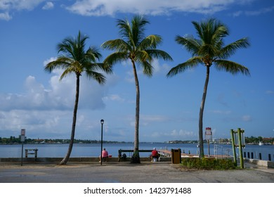 There are two fishermen in the waters of Lantana, Florida.