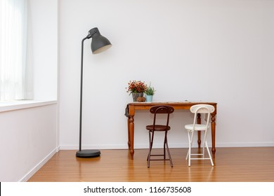 There are various funitures in the livingroom where has a large floor made of wood. Interior of here is bright and clean because of white color wall and good natural light.