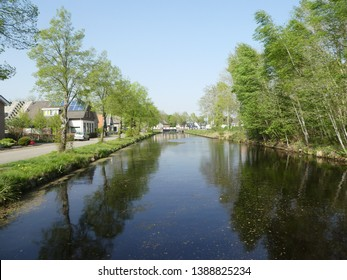 """There are wonderful canals on this historic boat route """" Drentsche Hoofdvaart"""" through the dutch state Drenthe and long avenues with beautiful trees   to the left and right of the shore."""