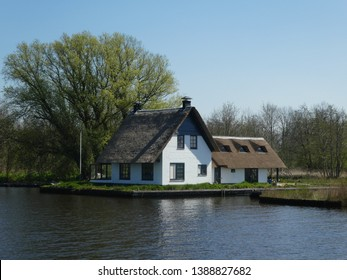 """There are wonderful canals on this historic boat route """" Drentsche Hoofdvaart"""" through the dutch state Drenthe and long avenues with beautiful trees and houses   to the left and right of the shore."""