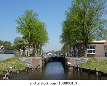 """There are wonderful canals on this historic boat route """" Drentsche Hoofdvaart"""" through the dutch state Drenthe and long avenues with beautiful trees and houses. Here the ancient """"paradise-lock"""""""
