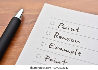 """There's a checklist of """"Point, Reason, Example, Point"""" with a pen."""