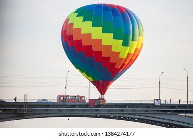 thermal balloon flying near a bridge
