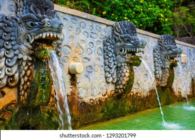 Thermal bath with sulphur mineral water in natural hot spring resort Air Panas Banjar. Popular place for day tour on family vacation. Travel destination, traditional balneotherapy spa in Bali island