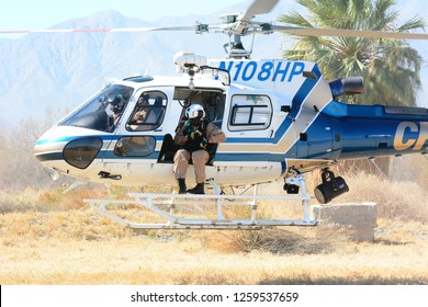 THERMAL, CALIFORNIA - FEBRUARY, 25, 2015: California Highway Patrol Helicopter hovering just above ground during inter-agency training exercises with State Park Rangers.
