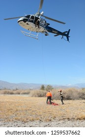 THERMAL, CALIFORNIA - FEBRUARY, 25, 2015: Ground crew preparing litter to be airlifted during California Highway Patrol Helicopter inter-agency training exercises with State Park Rangers.