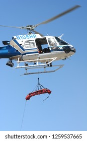 THERMAL, CALIFORNIA - FEBRUARY, 25, 2015: Litter bieng hoisted to California Highway Patrol Helicopter during inter-agency training exercises with State Park Rangers.