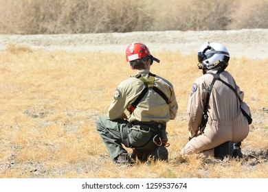 THERMAL, CALIFORNIA - FEBRUARY, 25, 2015: California Highway Patrol Crew waiting helicopter pickup during inter-ageny training exercises with State Park Rangers.