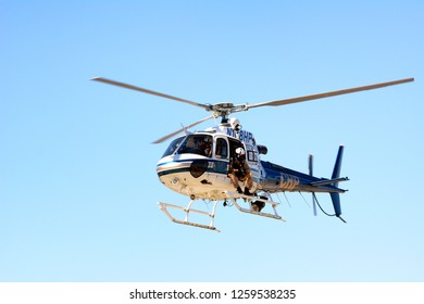 THERMAL, CALIFORNIA - FEBRUARY, 25, 2015: California Highway Patrol Helicopter with officer in open door.