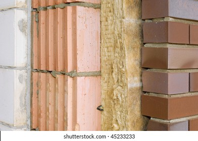 Thermal insulation of a house wall on a building site