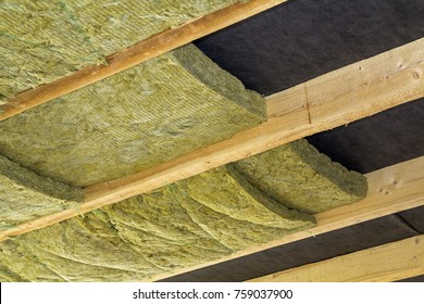 Thermal insulation mineral rock wool installation at the new building attic ceiling