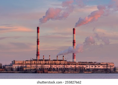 thermal power plant with smoke from its stacks