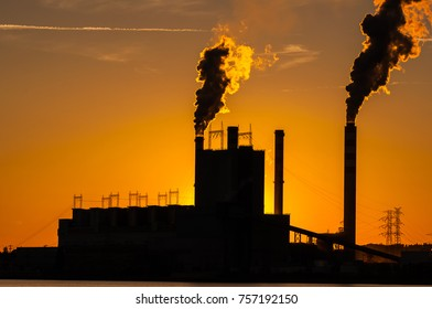 Thermal power plant station with big chimneys by the sunset in Poland