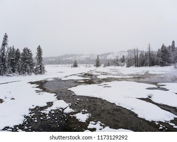 Thermal springs running through the snow - Yellowstone National Park, USA