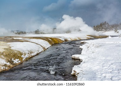 Thermal steam rises from hot water in Yellowstone in winter