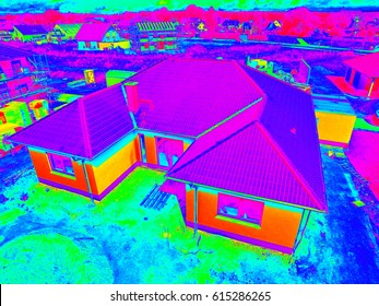 Thermal - Thermographic aerial view of a modern new suburban house