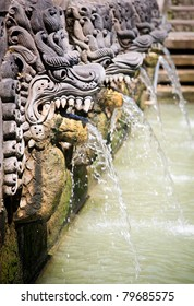 Thermal water is released from the mouth of statues at a hot springs in Banjar, Bali, Indonesia