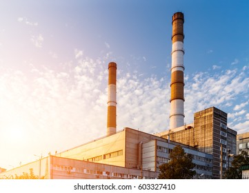 Thermoelectric plant with chimney towers on the sky background