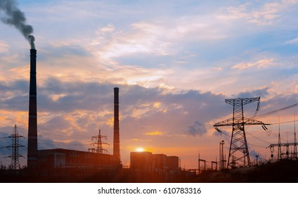 Thermoelectric station generanting smokes at the sunset