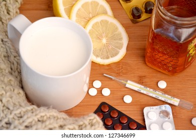 Thermometer and cold and flu remedy. Milk. honey and lemon