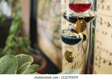 Thermometer with colorful glass bubbles in liquid giving indoor temperature