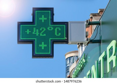 Thermometer in green pharmacy screen sign displays extremely hot temperature of 42 degrees Celsius during heatwave / heat wave in summer in Belgium