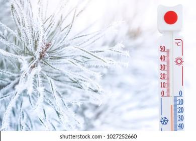 Thermometer registering temperature below zero outdoor