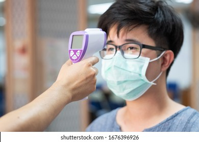A thermometer Scan Fever And Symptoms of Coronavirus at College , School , Office , Mall , Hospital