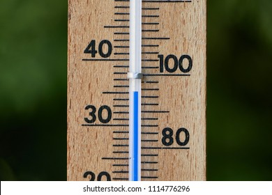 Thermometer showing hot summer temperatures outside