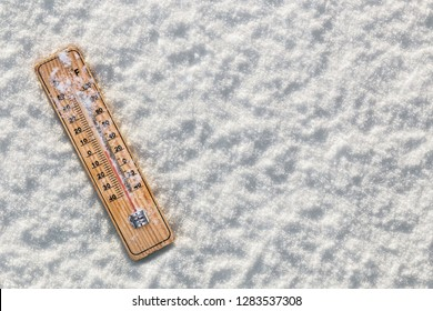thermometer with sub-zero temperatures in the snow. Snow-covered white background