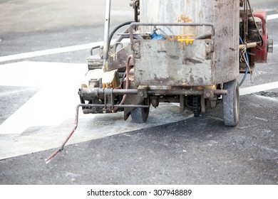 Thermoplastic spray marking machine during road construction works
