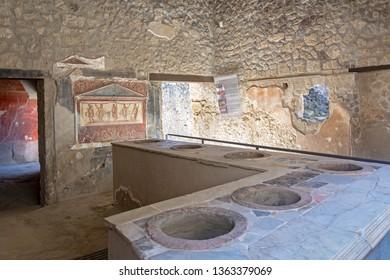 Thermopolium of Vetutius Placidus forerunner of today's restaurant at the ancient Roman city of Pompeii, Italy.