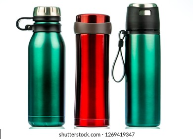 Thermos bottle isolated on white background. Coffee or tea reusable bottle container. Thermos travel tumbler. Insulated drink container. Red and green stainless steel thermos water flask. Zero waste.