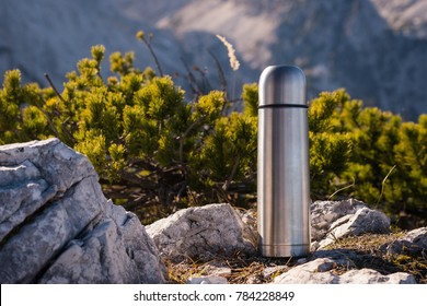Thermos Vacuum flask in the mountains