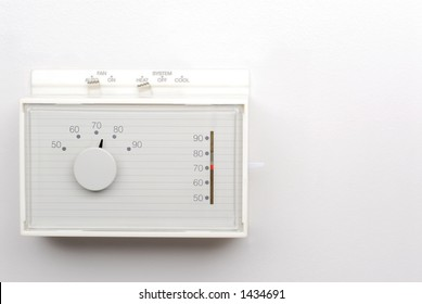 Thermostat on White Wall with Space for Text