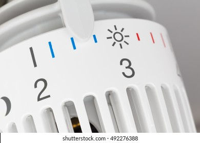 Thermostat set to low temperature, symbol for saving money at heating costs