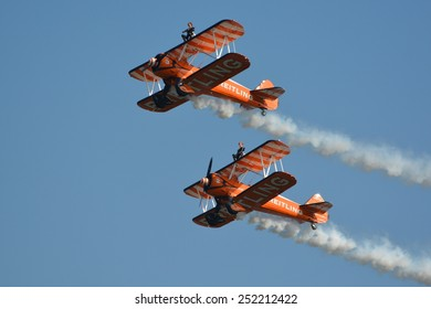 These are the Breitling wingwalkers. They fly acrobatic manoeuvres with Boeing Stearman biplanes. This picture was taken at the AIR14 show in Payerne, Switzerland on the 6th of September 2014.