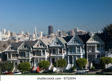 These are the famous six sisters homes in Alamo Square in San Francisco.The background shows downtown San Francisco.