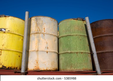 These fifty five gallon drums are stored empty and rusting