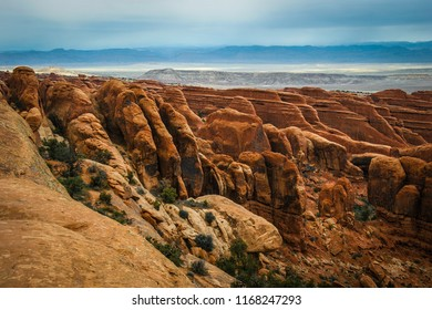 These are fin formations on the Devil's Garden Loop Trail in Arches National Park in Moab, Utah. The canyon floor is seen in the background with the mountains seen in the far distance.