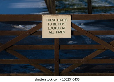 These gates to be kept locked at all times sign
